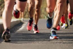 Marathon running. Leg pain and ITBS concept