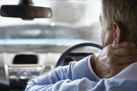 Man driving with neck pain