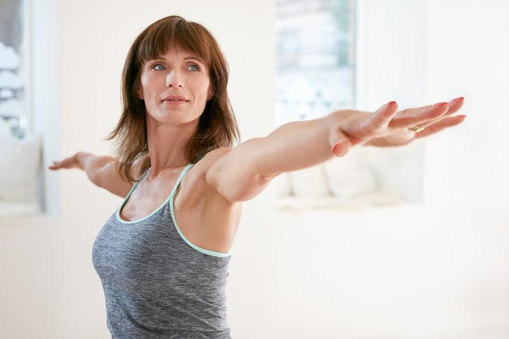 Woman using a shoulder stretch