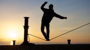 Man balancing on a tight rope