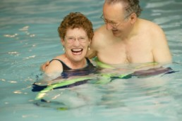 Senior couple benefiting from aquatic physical therapy