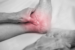 senior man hand holding he healthy foot and massaging ankle in pain area. Achilles tendonitis concept