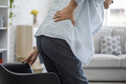 Old man with lower back pain