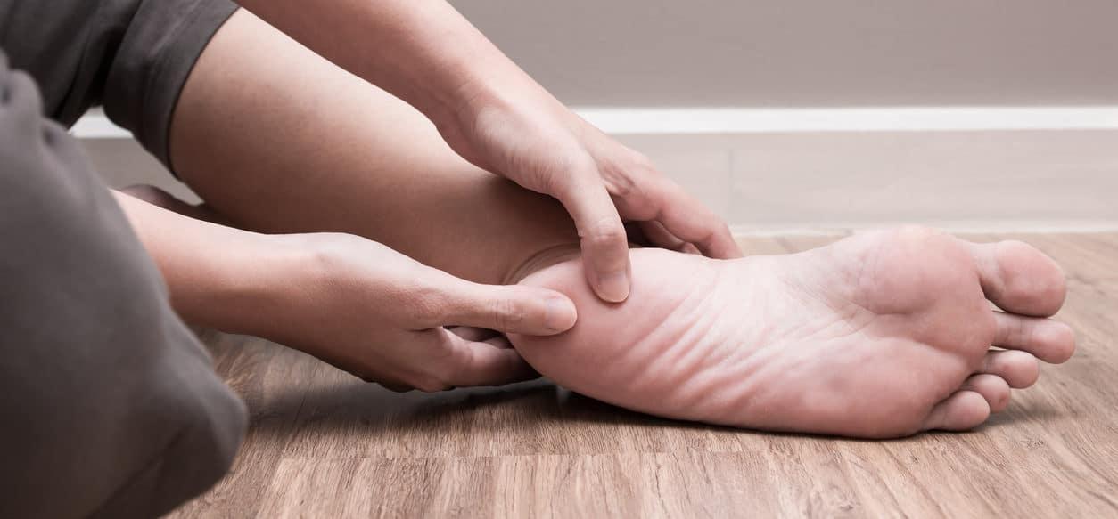 Female foot heel pain, plantar fasciitis
