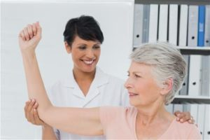Physical therapist working with senior patient
