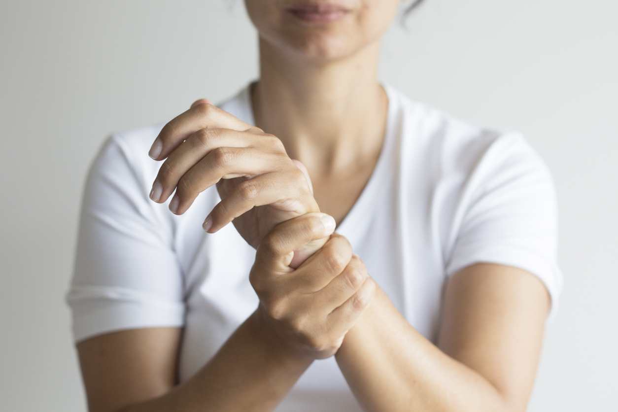 Woman holding her wrist in pain