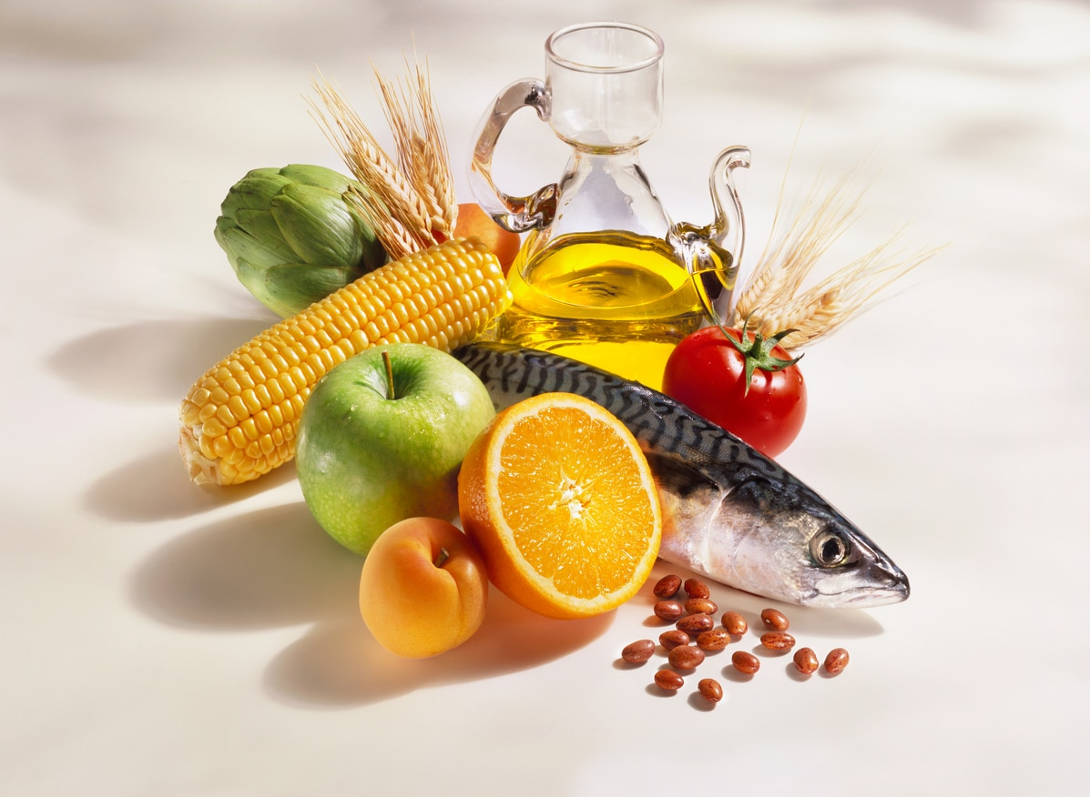 A beautiful group of products, (Fish, fruit, vegetables, cereals, beans, and olive oil) typical in the mediterranean diet