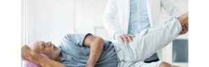 man with hip pain with a physical therapist