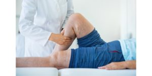 Woman sees a physical therapist for compensation injuries.