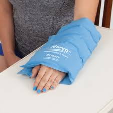 Woman using ice pack for wrist pain