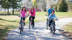 Family riding their bikes together