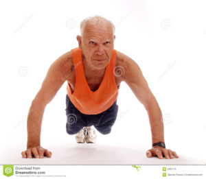 Senior man performing pushups