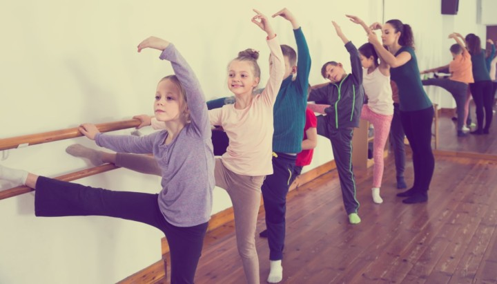 kids dancing together in classroom as a good exercise for kids diagnosed with Osgood-Schlatter Disease