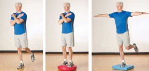 man practicing balancing exercises