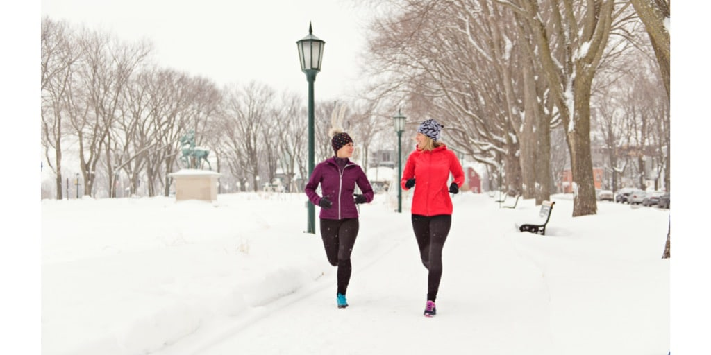 Two friends going on a healthy jog to Preventing Cold Weather Muscle Injuries