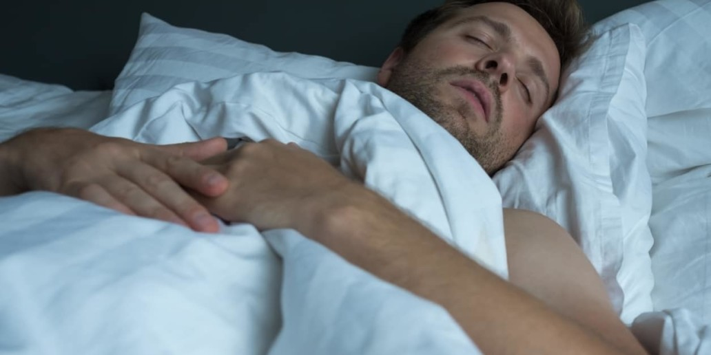 Man with back pain. napping on a poor mattress