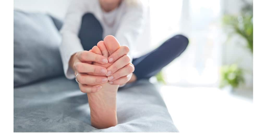 Senior woman holding her feet because of foot pain due to Morton's Neuroma