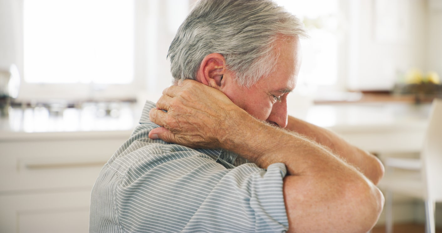 Shot of a senior man experiencing frozen shoulder pain at home doing exercises