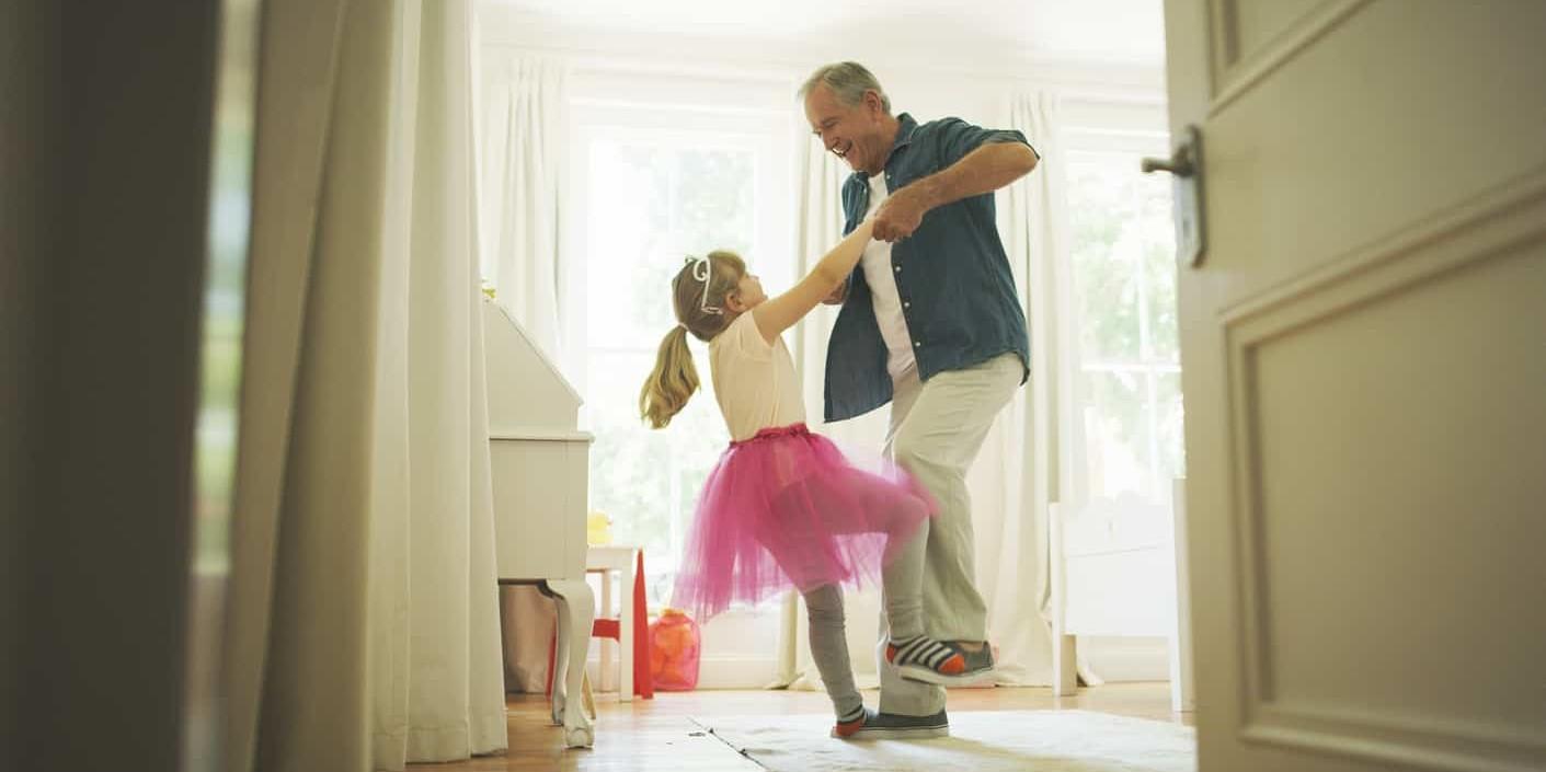 grandpa dancing with grandchild