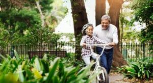 Grandparent and kid riding bike