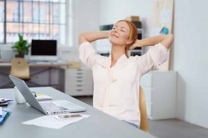 Person stretching shoulders in office | winged scapula Cawley Physical Therapy and Rehab