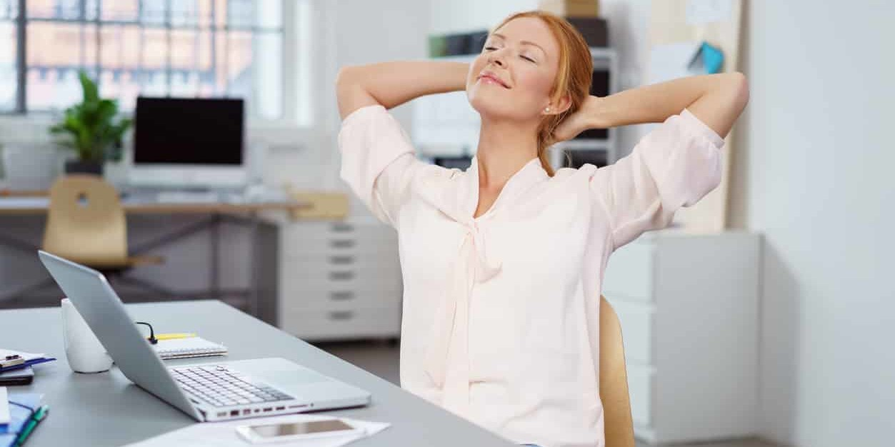 Person stretching shoulders in office   winged scapula Cawley Physical Therapy and Rehab